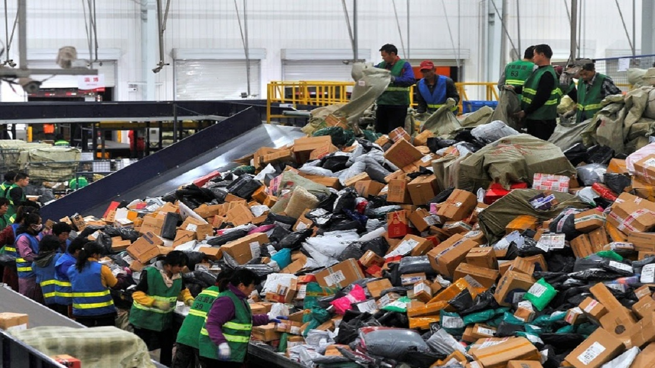 Employees sort boxes and parcels at a logistics centre of BEST Express delivery company, after the Singles' Day online shopping festival, in Jinan, Shandong province, China.