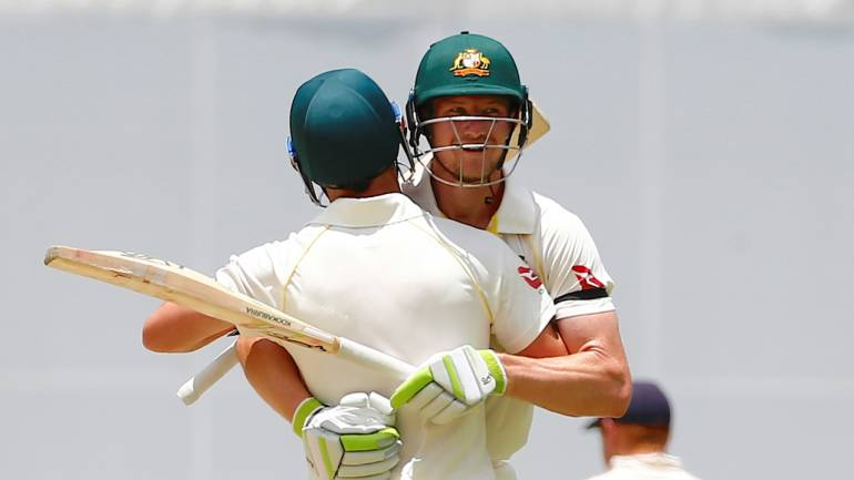 Ashes test match - Australia v England: Australia's Cameron Bancroft hugs team mate David Warner after hitting the winning runs to win the first Ashes cricket test match. (Reuters)