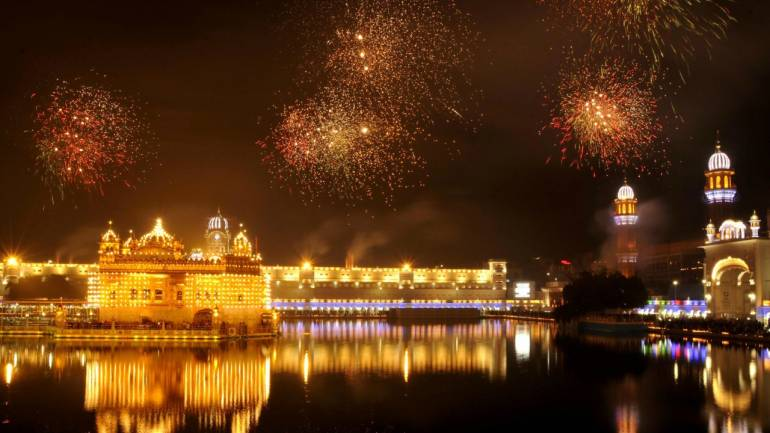 The Golden Temple Illuminated on the occasion of the 351st birth anniversary of the tenth Guru of Sikhs, Sri Guru Gobind Singhji in Amritsar (PTI)