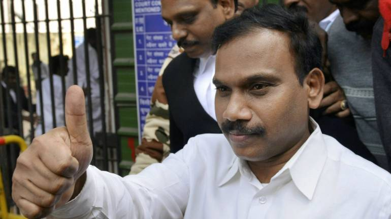 Former telecom minister A Raja reacts as he leaves the Patiala House Courts after he was acquitted by a special court in the 2G scam case, in New Delhi on Thursday. (PTI)