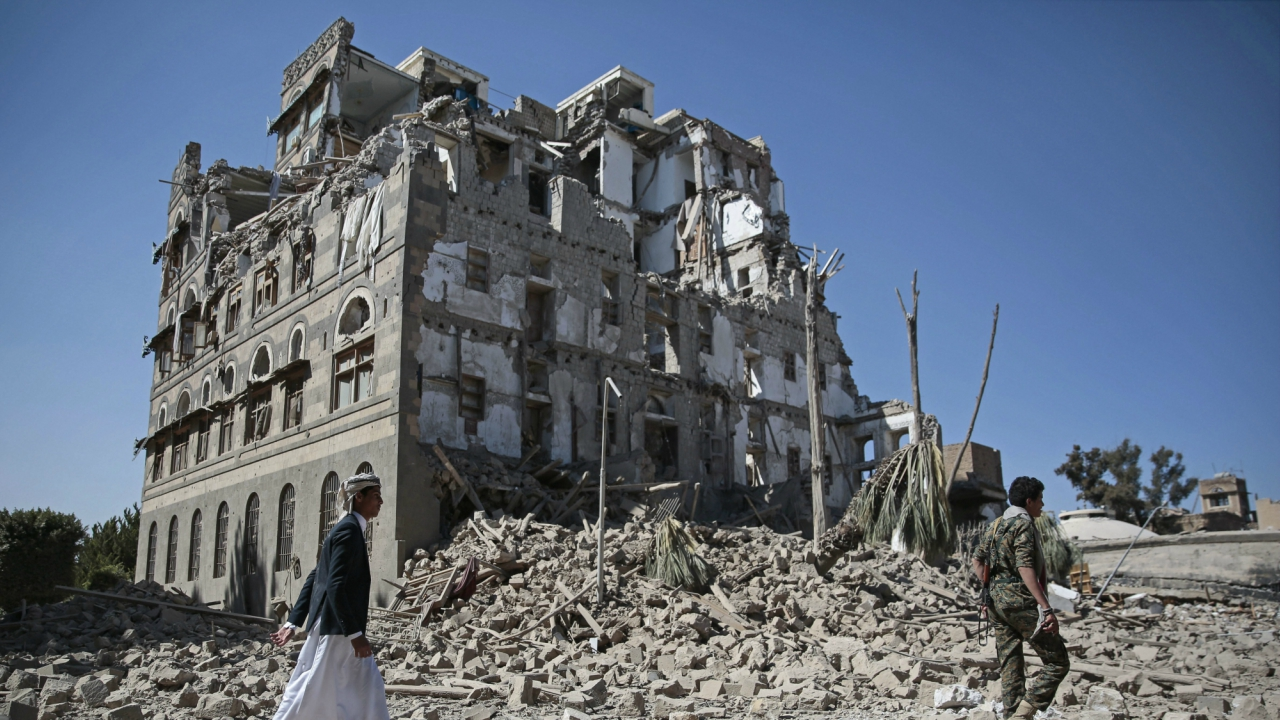Houthi Shiite rebels walk amid the rubble of the Republican Palace that was destroyed by Saudi-led airstrikes, in Sanaa, Yemen. (PTI)