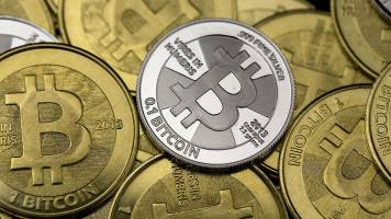 Bitcoin slumps below $10,000, half its peak, as regulatory fears intensify