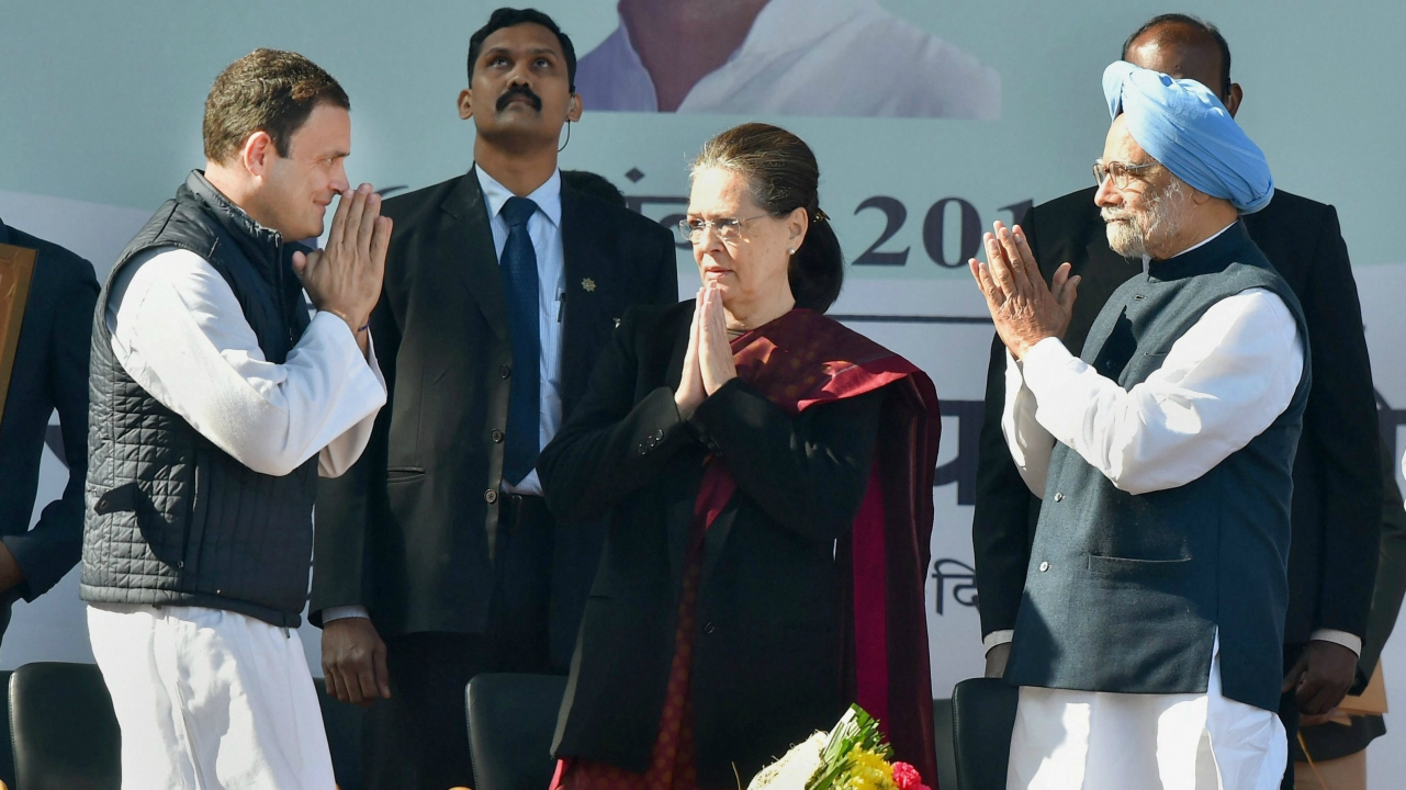 Congress chief Rahul Gandhi with his mother Sonia Gandhi and former prime minister Manmohan Singh during his elevation ceremony in New Delhi. (PTI)