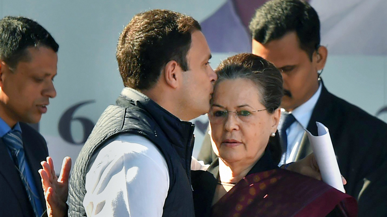 Newly elected Congress president Rahul Gandhi greets his mother and predecessor Sonia Gandhi after her speech during a grand elevation event in New Delhi. (PTI)