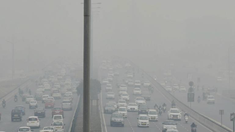 Delhi Smog - Vehicles move in a dense smog at Delhi-Gurgaon Expressway. (PTI)