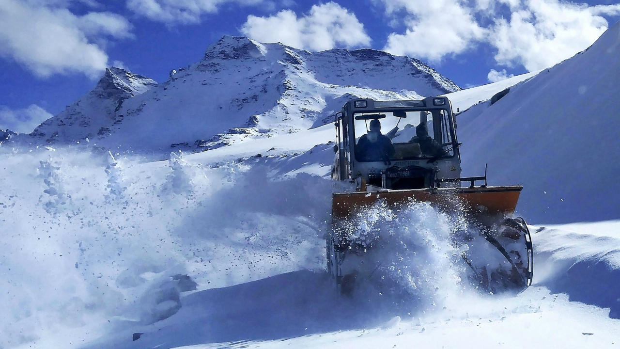 A BRO snowcutter removes snow from a road after fresh snowfall, at Rohtang Pass. (PTI)
