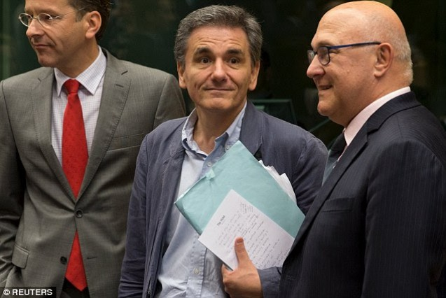 Answer 21 | Euclid Picture on the right: Euclid in Raphael School of Athens | Picture on the left: Greece finance minister Euclid Tsakalotos notes on Hotel note paper. Greece's new finance minister Euclid Tsakalotos has accidentally revealed the key negotiation tactics he is using during crunch talks with Eurozone leaders to discuss Greece's future. In only his second day in the job, Tsakalotos posed for photographs alongside Dutch finance minister and Eurogroup president, Jeroen Dijsselbloem, but failed to conceal his notes. Scrawled on hotel note paper and written in English, the plans include phrases such as 'political situation,' 'no triumphalism' and 'message to people' - which may well have been reminders for the tone Tsakalotos hoped to strike following Greece's historic 'no' vote in a bailout referendum.