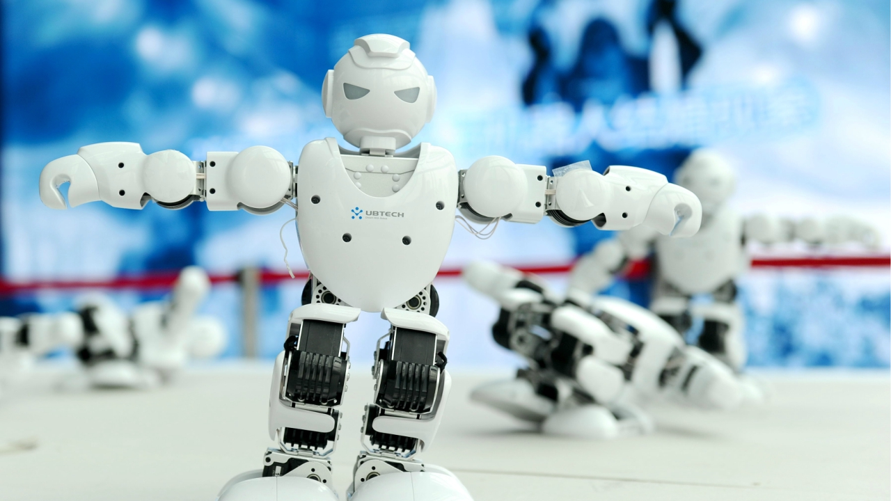 Humanoid robots developed by UBTECH perform a synchronised dance at the World Intelligent Manufacturing Summit in Nanjing, Jiangsu province, China. (Reuters)