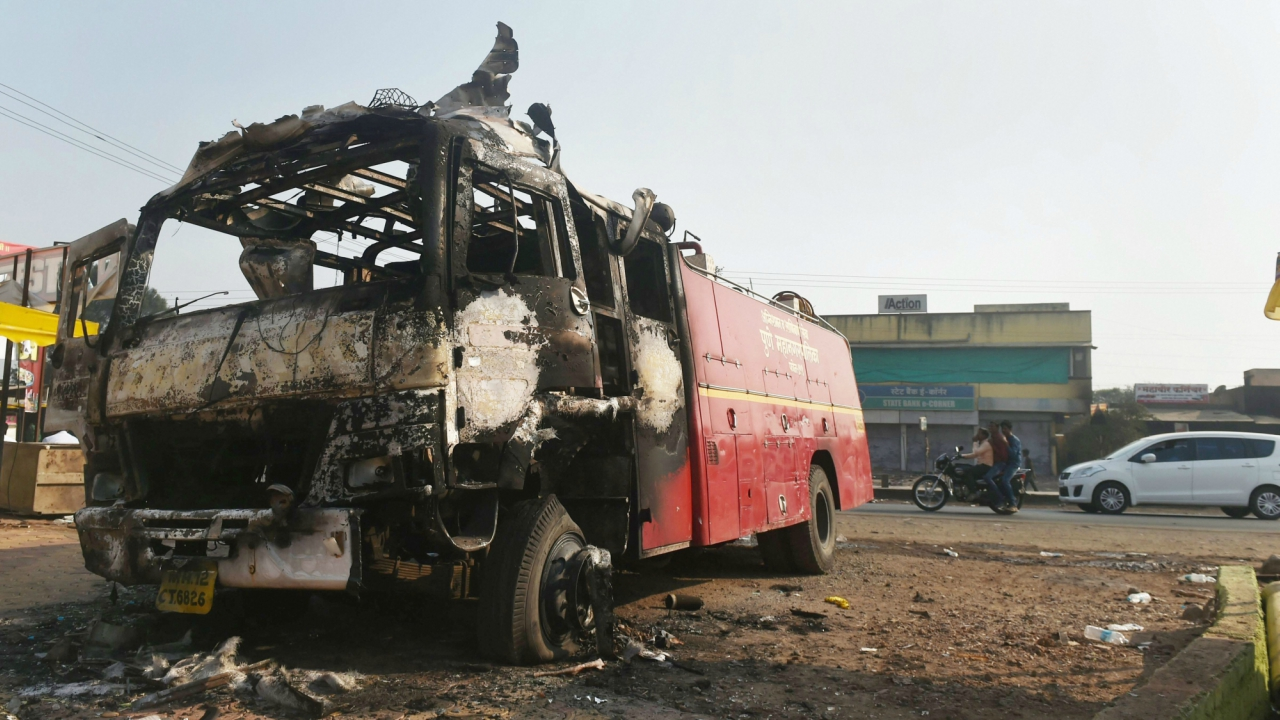 Charred remains of a fire fighting vehicle following the violence. (PTI)