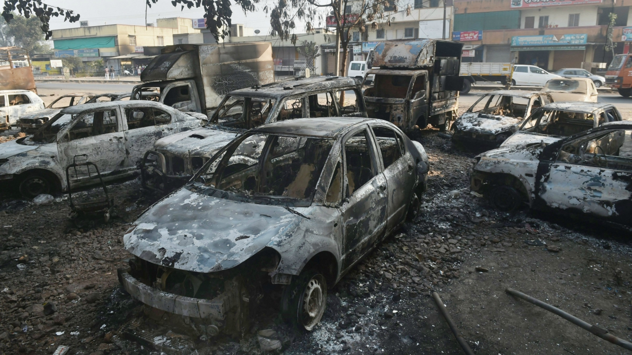 Charred vehicles following the violence near Pune. (PTI)