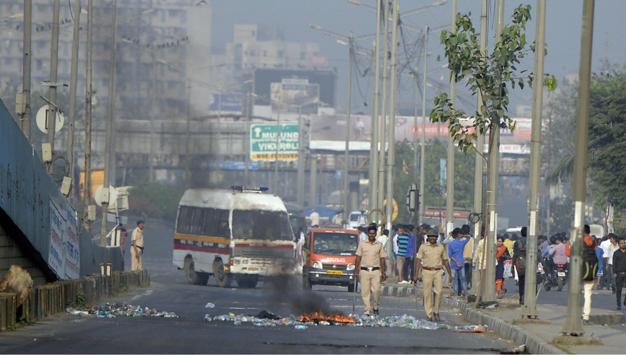 Policemen try to control the situation after a violent protest by the Dalits. (PTI)