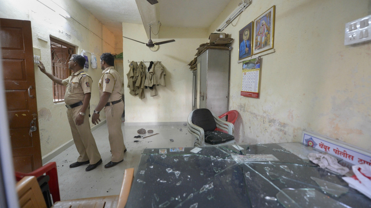 Police officials inspect a Police Station that was vandalised by Dalit groups. (PTI)