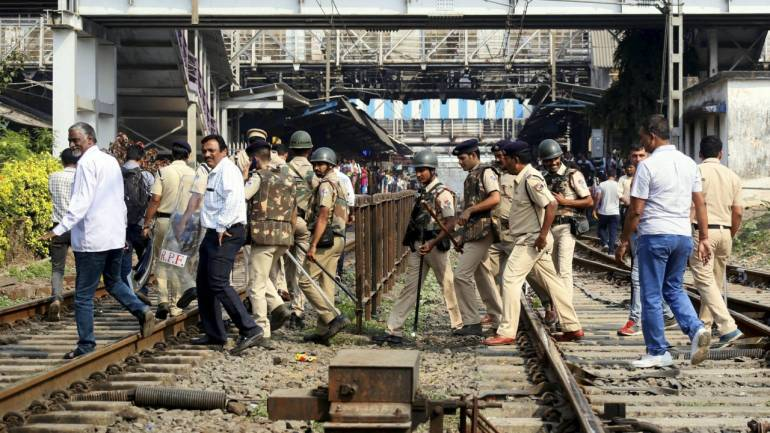 Police officials patrolling at railway tracks. (PTI)