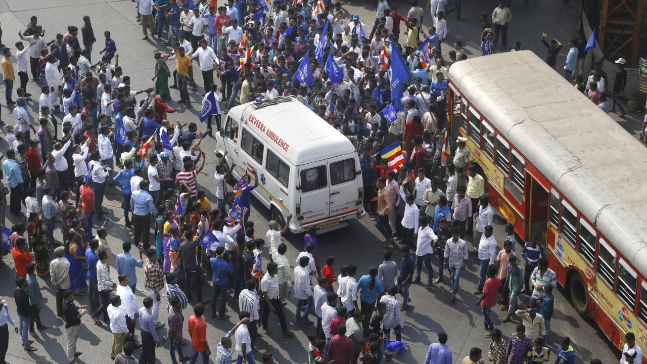 Dalit protesters block a road in Thane. (PTI)