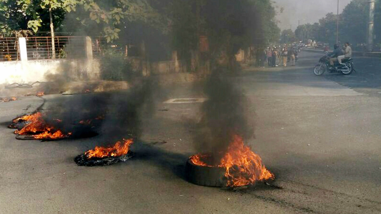 Protesters burn tyres to block a road during the  Maharashtra Bandh. (PTI)