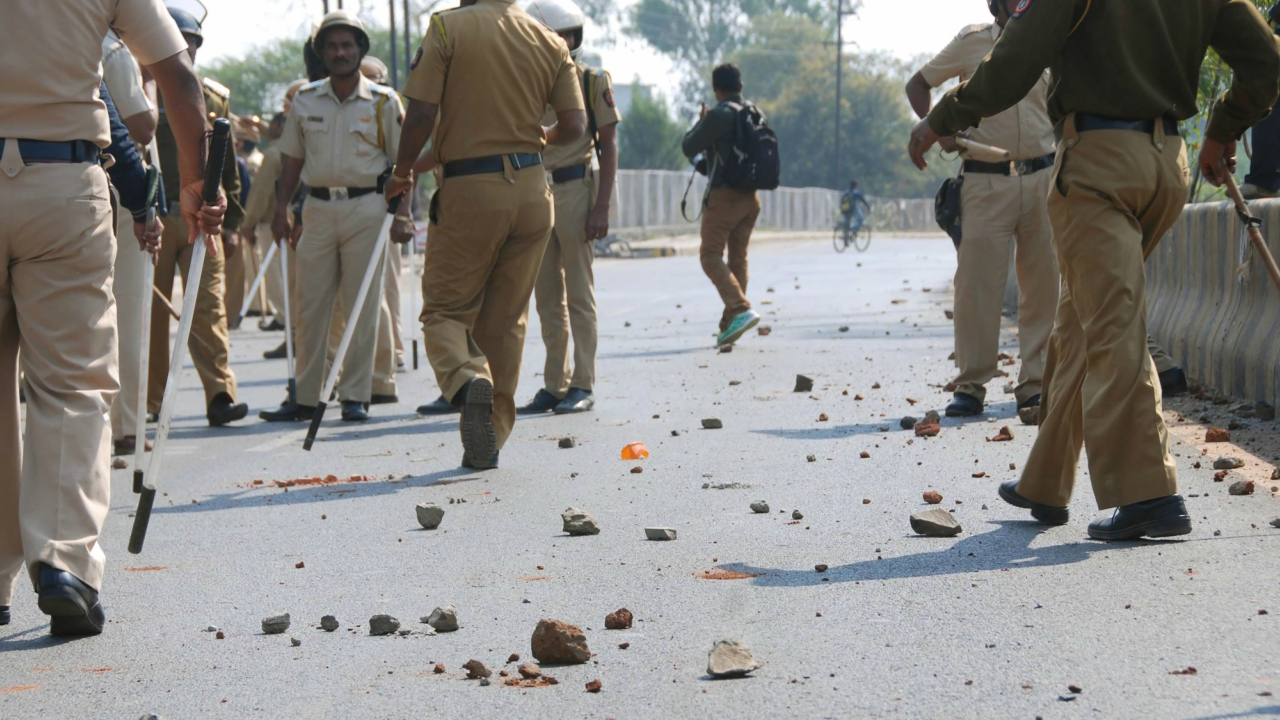 Police personnel arrive to control the situation after an incident of violent clash at Ambedkar Nagar in Aurangabad. (PTI)