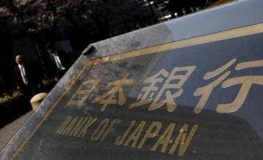 Bank of Japan keeps policy steady, cuts inflation forecast