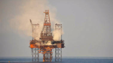 Oil dips as emerging market woes dim demand outlook; Iran sanctions offer support