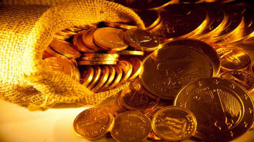 Gold falls to four-month low on firm dollar, risk sentiment