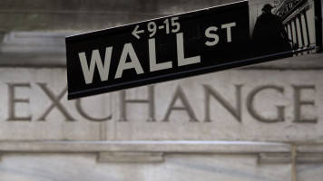 S&P 500 hits record high as Fed signals rate cuts