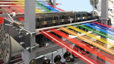 Ministry signs pacts with leading textile cos to help weavers