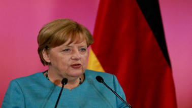 Merkel narrowly elected to fourth term as German chancellor