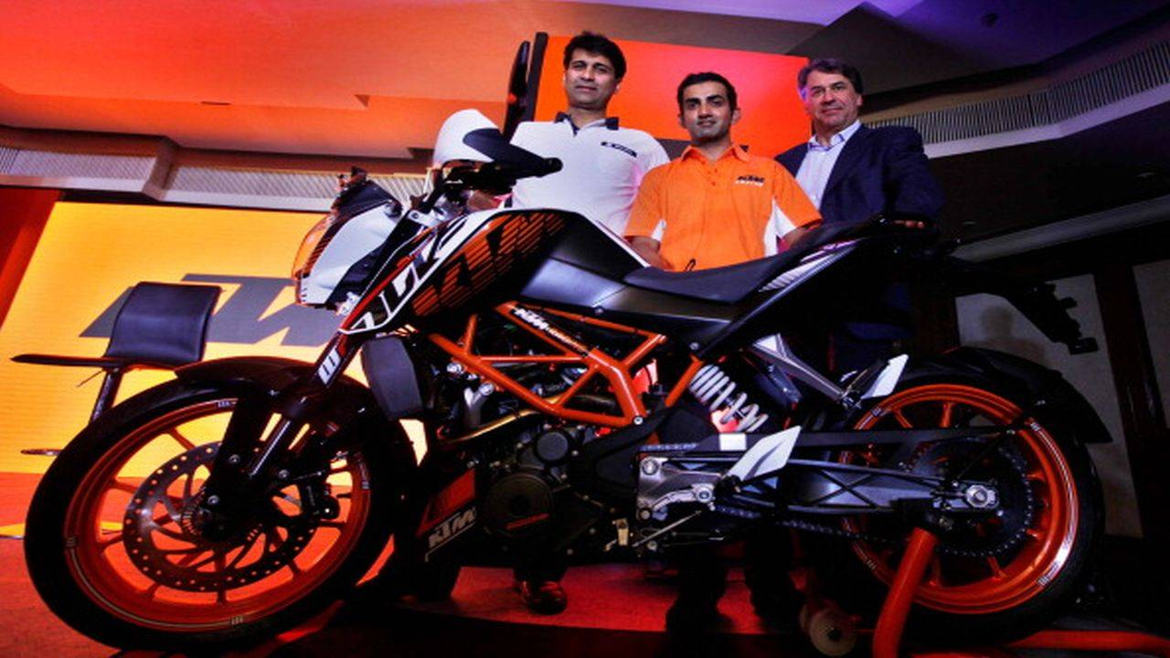 NEW DELHI, INDIA - NOVEMBER 20: (L-R) Mr. Rajiv Bajaj, MD Bajaj Auto Ltd., Indian Cricketer Gautam Gambhir and Mr. Stefan Pierer, and CEO KTM Sportmotorcycles AG, Bajaj during the launch of KTM Duke 390 on November 20, 2013 in New Delhi, India. KTM Duke 390, which was launched in India for a starting price of Rs 1.8 lakh, is the best selling bike in the 400cc segment. (Photograph by Raj k Raj/Hindustan Times via Getty Images)