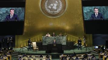 Draft agreement emerges at UN climate talks, pitfalls remain