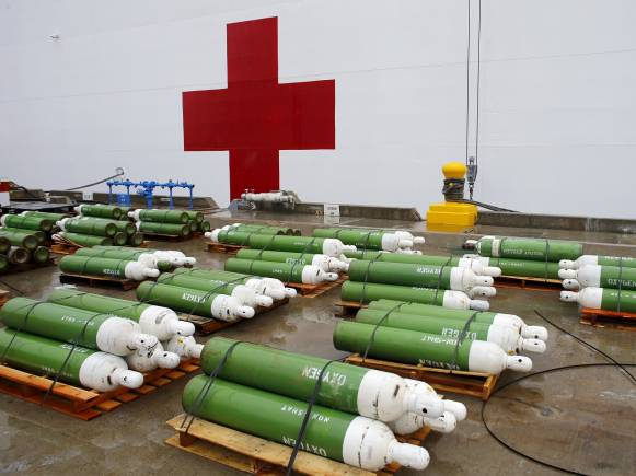 Oxygen bottles wait to be loaded onto the hospital ship USNS Mercy (T-AH 19) prior to its departure from Naval Base San Diego on a four month Pacific Partnership humanitarian deployment to the South Pacific May 15, 2015. The ship has a 1,000 patient bed capacity, four X-ray rooms a CT scan unit as well as a optometry and lens laboratory. REUTERS/Mike Blake - GF10000096460