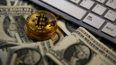 Bitcoin hits one-year low as slump continues; ethereum drops sharply