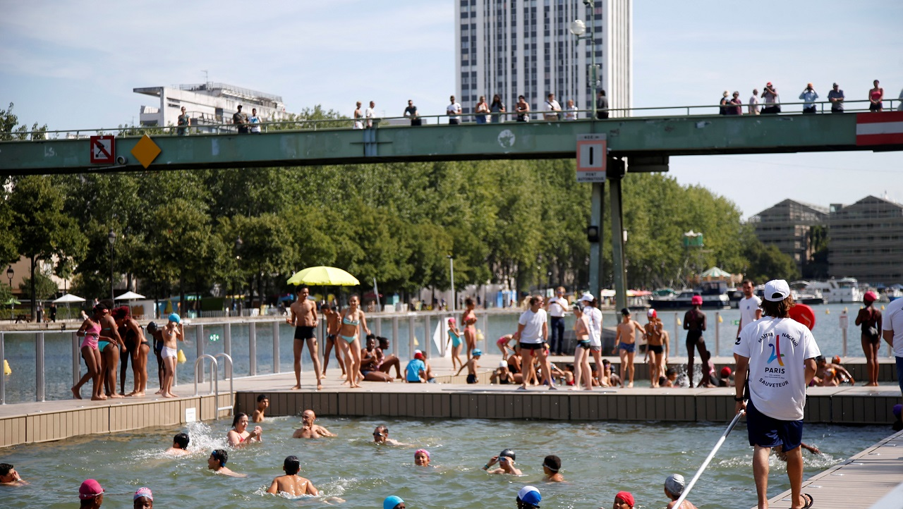 A lifeguard watches over swimmers of the three swimming areas open up along the Bassin de la Villette, as part of the Paris Plages summer festival in Paris, France, July 18, 2017. REUTERS/Charles Platiau - RC1A46C619A0