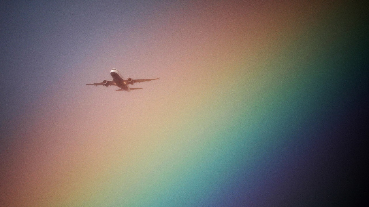 A British Airways airplane flies near a rainbow on its way to Heathrow Airport in London, Britain on July 23, 2017. (Reuters)