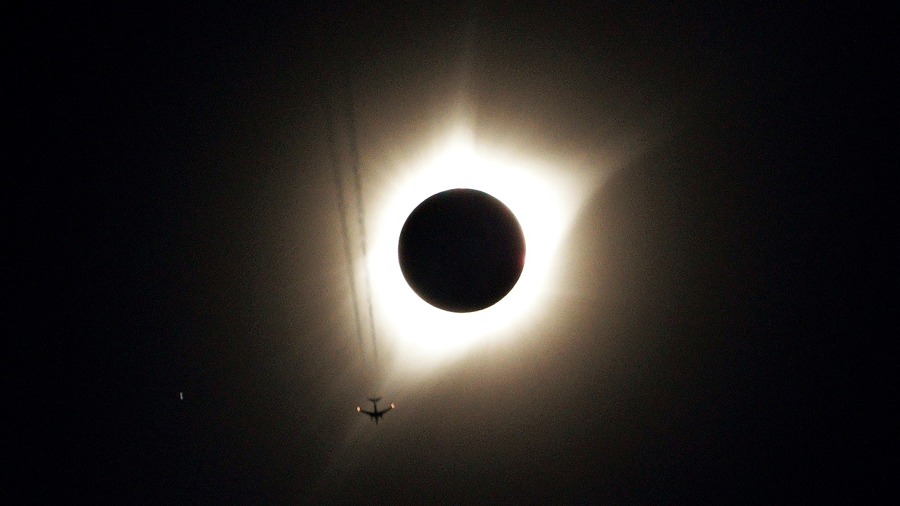A jet plane flies by the total solar eclipse in Guernsey, Wyoming, US on August 21, 2017. (Reuters)