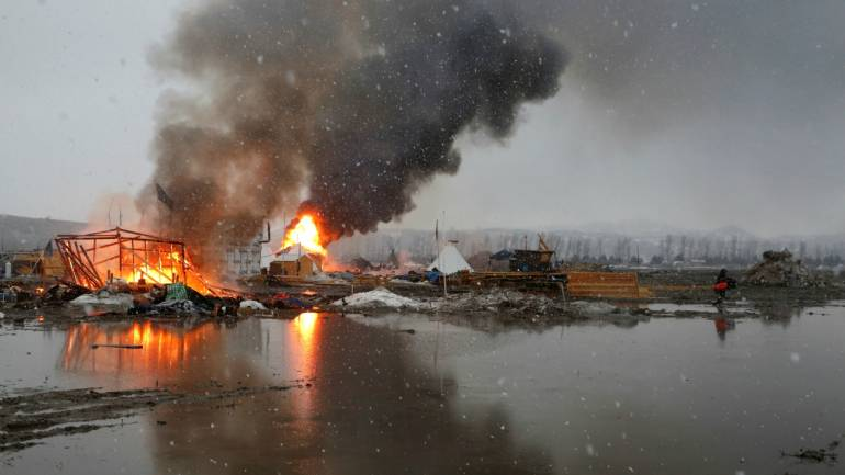 Buildings burn after being set alight by protesters preparing to evacuate the main opposition camp against the Dakota Access oil pipeline near Cannon Ball, North Dakota on February 22, 2017. (Reuters)