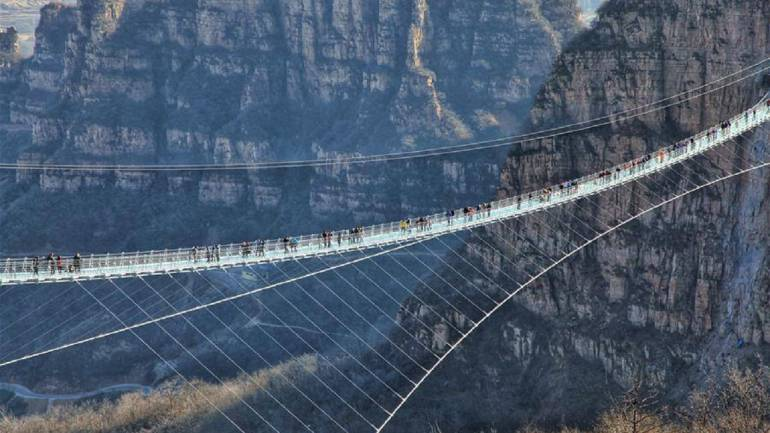 World's tallest and longest glass bridge opens in China - here are some  pictures