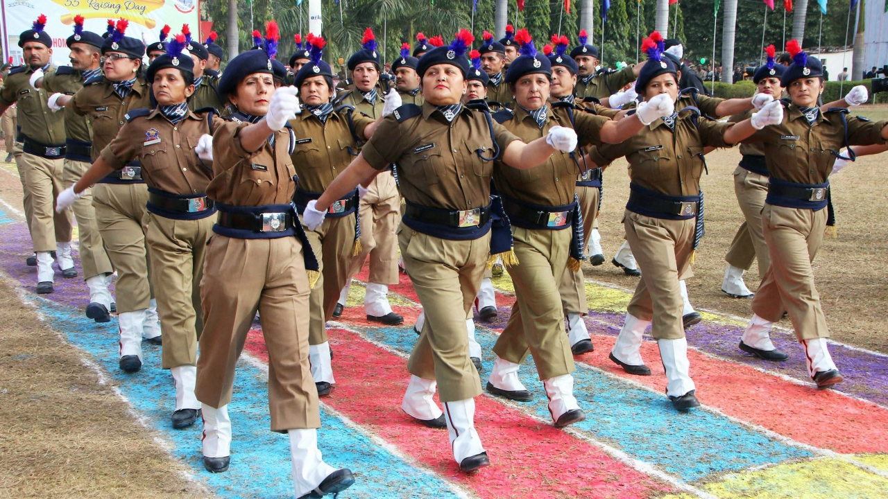 J & K homeguards march past during 55th Annual Rasising Day of Homeguards/Civil Defence at SDRF 2nd Battalion, in Jammu on Wednesday. (PTI)