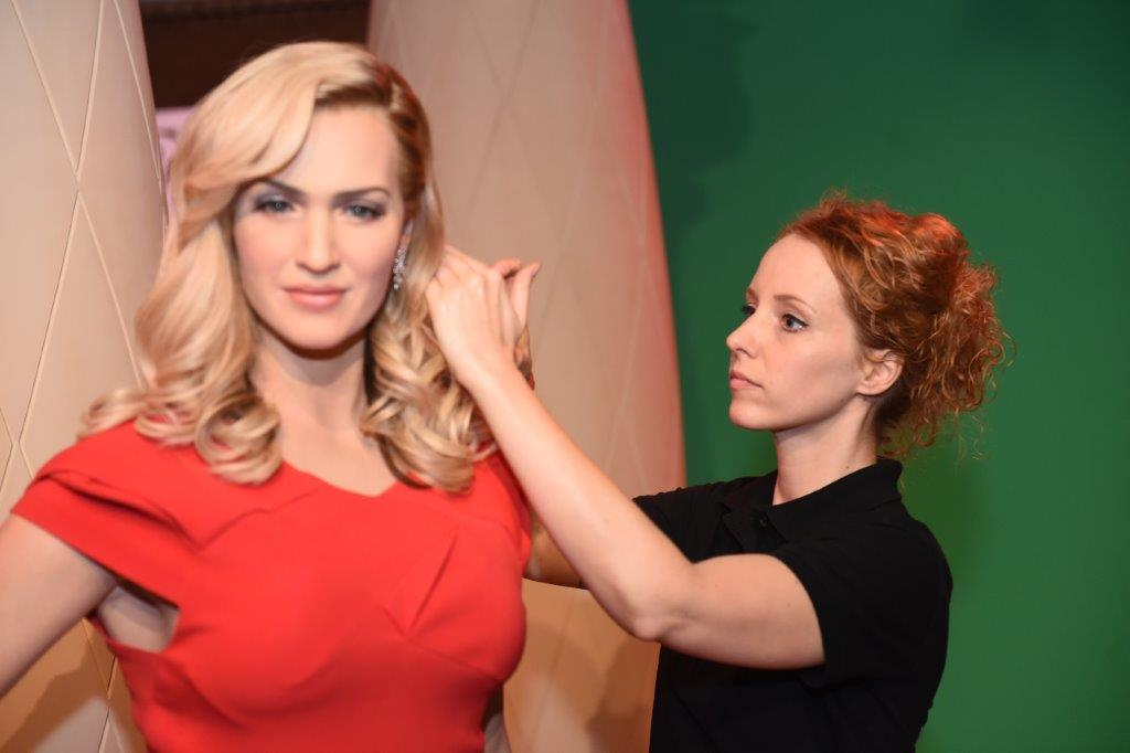 The Dressmaker | A worker gives finishing touches to the wax statue of English actress Kate Winslet. Apart from these celebrities, the museum showcases wax figures of Leonardo De Caprio, Madhubala, Mahatma Gandhi, Sachin Tendulkar, Lionel Messi, Bhagat Singh among many. (Source: Madame Tussauds Delhi)
