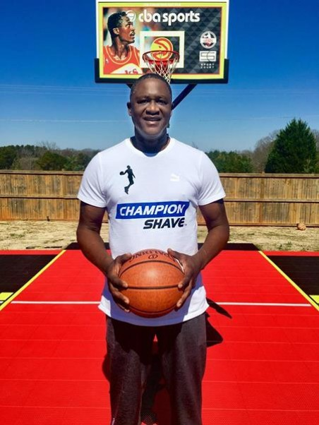 The man in the picture is NBA great Dominique Wilson. He is shown wearing a T-Shirt with the name Champion Shave printed on it. Who owns Champion Shave?