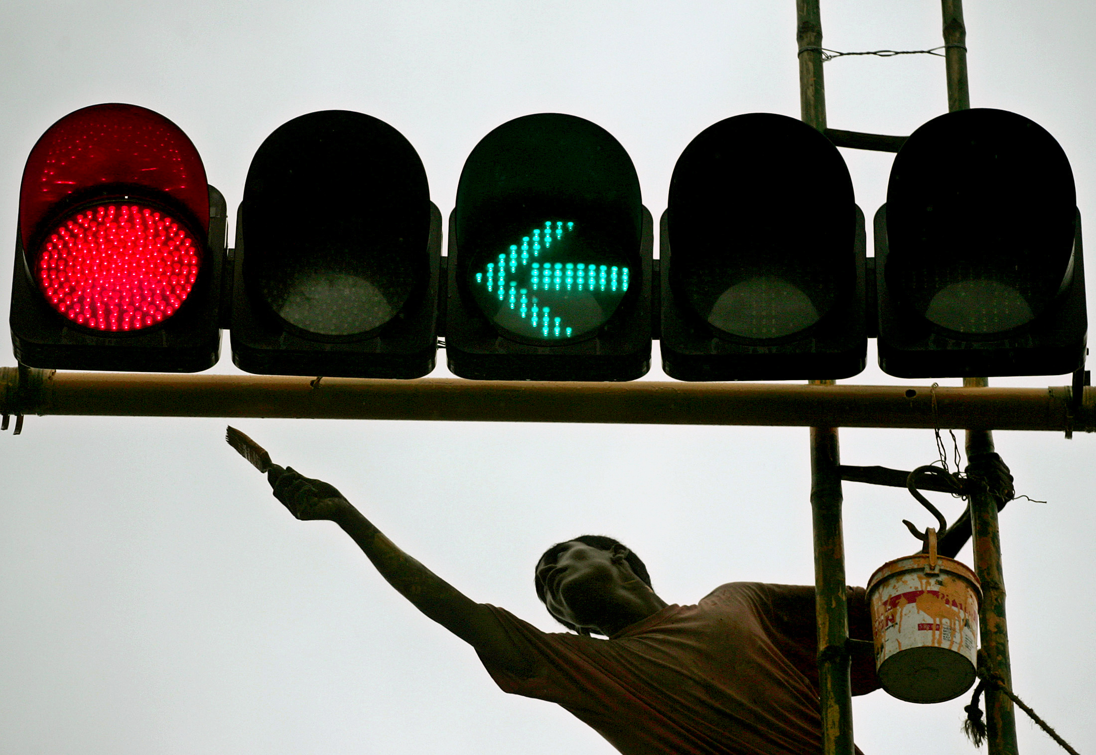 "Q11. This man created the first traffic light that included a third ""warning"" position. Who is he? (Image: Reuters)"
