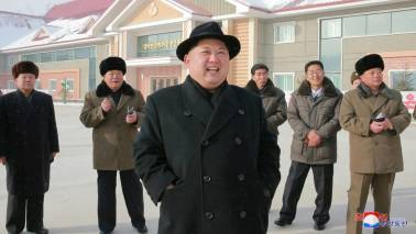 North Korea warms to South after visit, pressure to be kept in place for now