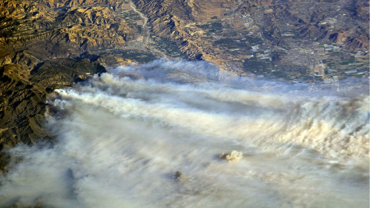 A photo taken from the International Space Station and moved on social media by astronaut Randy Bresnik shows smoke rising from wildfire burning in Southern California, US. (Reuters)