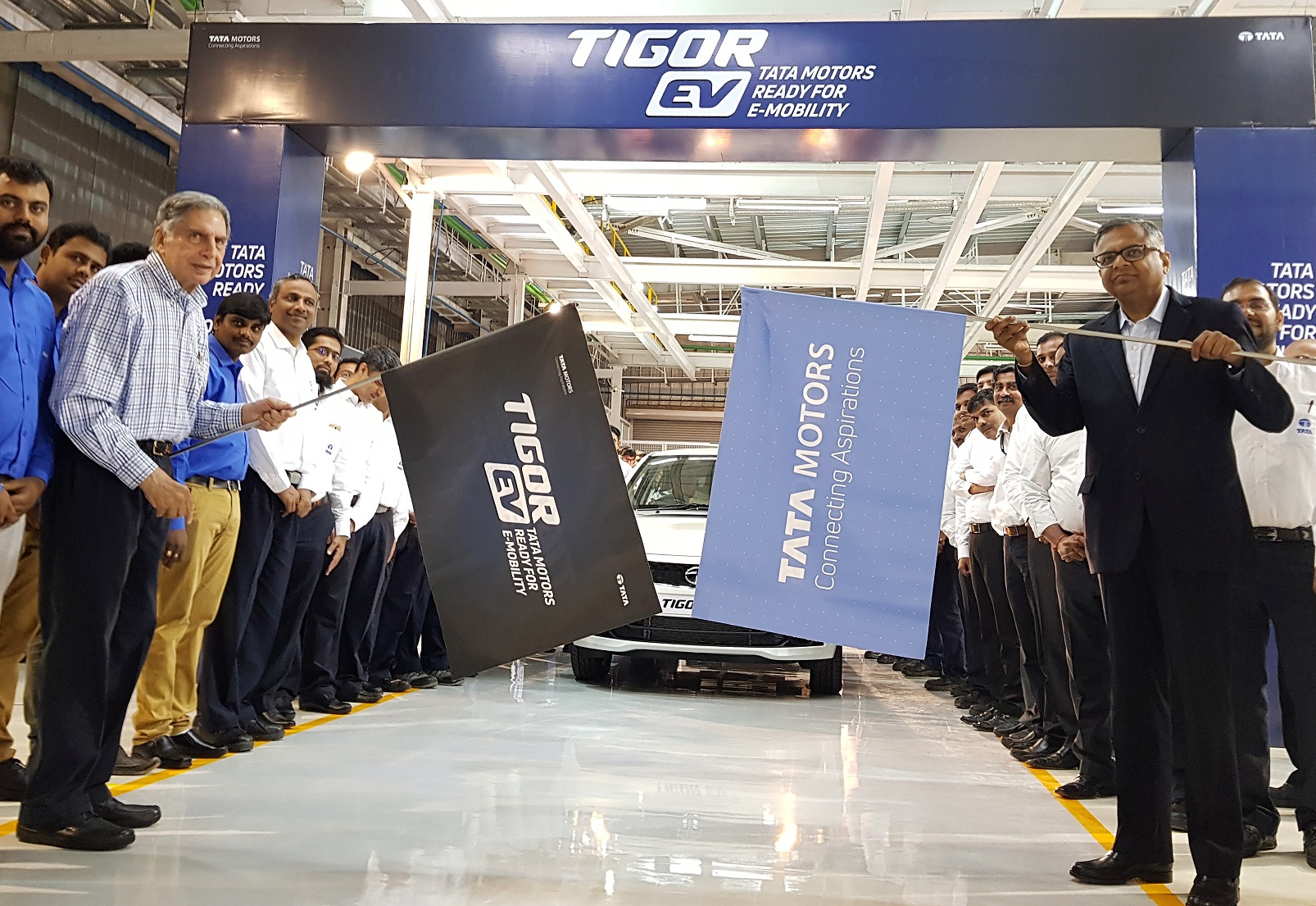 Ratan Tata and N Chandrasekaran flag-off the roll out of the first batch of electric Tigors from Sanand plant in Gujarat