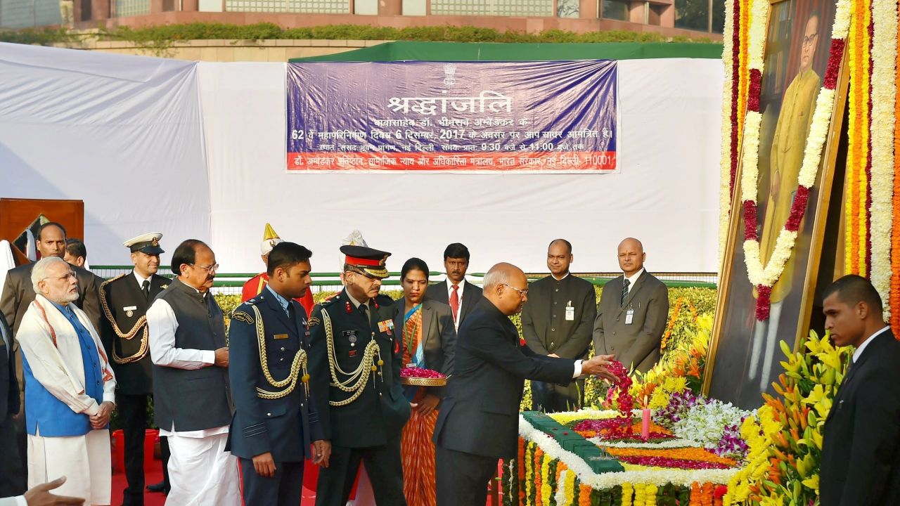 President Ram Nath Kovind, Vice President M Venkaiah Naidu and Prime Minister Narendra Modi while paying tributes to Bhim Rao Ambedkar on the occasion of his 'Mahaparinirvan Diwas' at Parliament House Lawns, in New Delhi on Wednesday. (PTI)