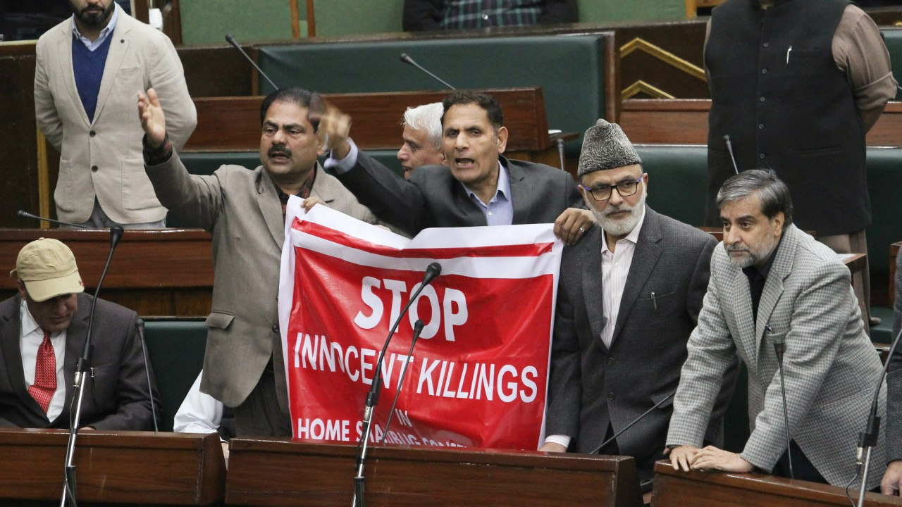 Jammu & Kashmir National Conference MLAs raise slogans inside the legislative assembly during the budget session in Jammu. (PTI)