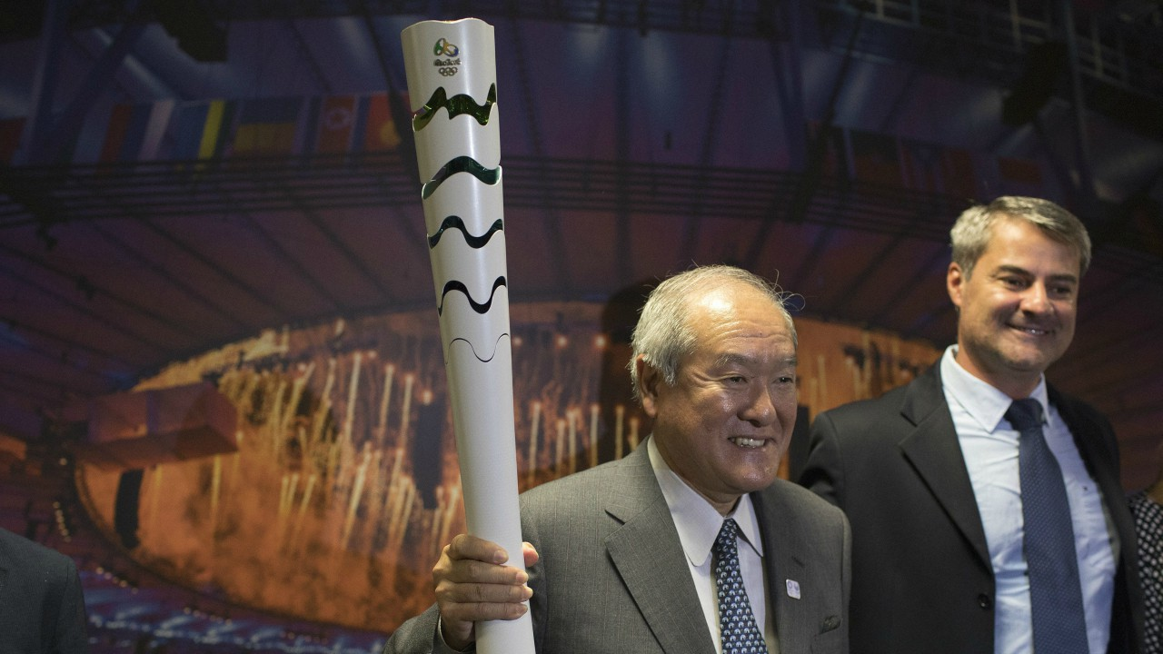 Shunichi Suzuki, minister of the 2020 Tokyo Olympic and Paralympic Games, poses for a photo with the Rio 2016 Olympic torch accompanied by Paulo Marcio Dias Mello, head of the Governing Authority of the Olympic Legacy (AGLO), at Olympic Park in Rio de Janeiro, Brazil (AP/PTI)