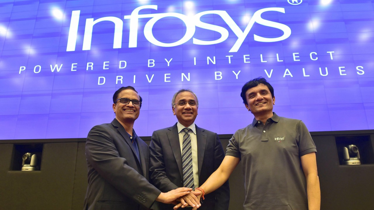 Newly Appointed Infosys CEO Salil Parekh(C) with CFO Ranganath and CTO Pravin Rao (L) during a press conference to announce the third quarter results of the company at its headquarters in Bengaluru on Friday. PTI Photo by Shailendra Bhojak   (PTI)