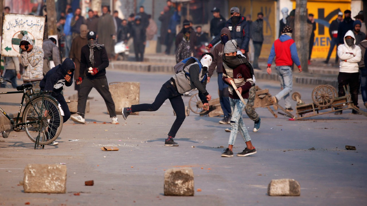 Demonstrators hurl stones towards the Indian police during a protest after Friday prayers in Srinagar. (REUTERS)