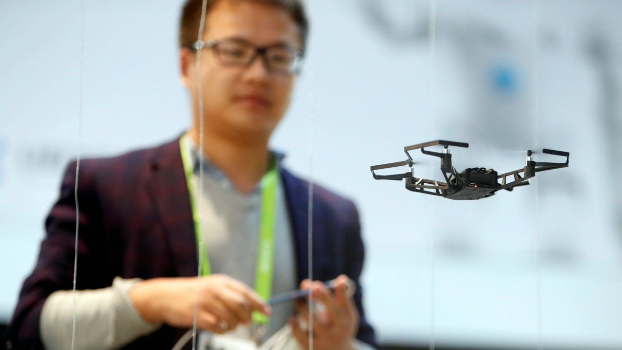 Xuefeng Chen of China operates a Kudrone drone using an iPhone during the 2018 CES in Las Vegas, Nevada, U.S (REUTERS)