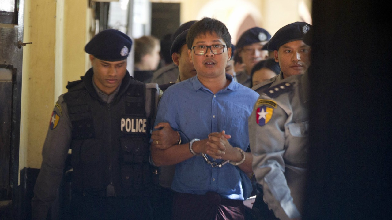 Reuters journalist Wa Lone is escorted by police as he leaves court outside Yangon, Myanmar. (AP/PTI)