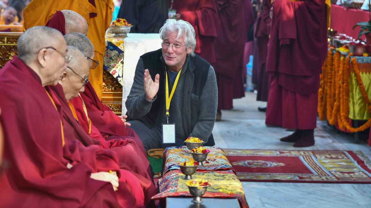 Hollywood actor Richard Gere interacts with Buddhist monks seated under The holy Bodhi Tree at the World Heritage Mahabodhi temple as they participate in the annual Nyingma Monlam (World Peace Prayer) in Bodhgaya (PTI)
